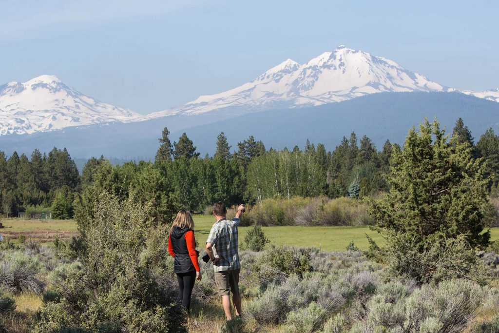 Hikers admiring the view of the mountains at Indian Ford Meadow Preserve by Jill Rosell