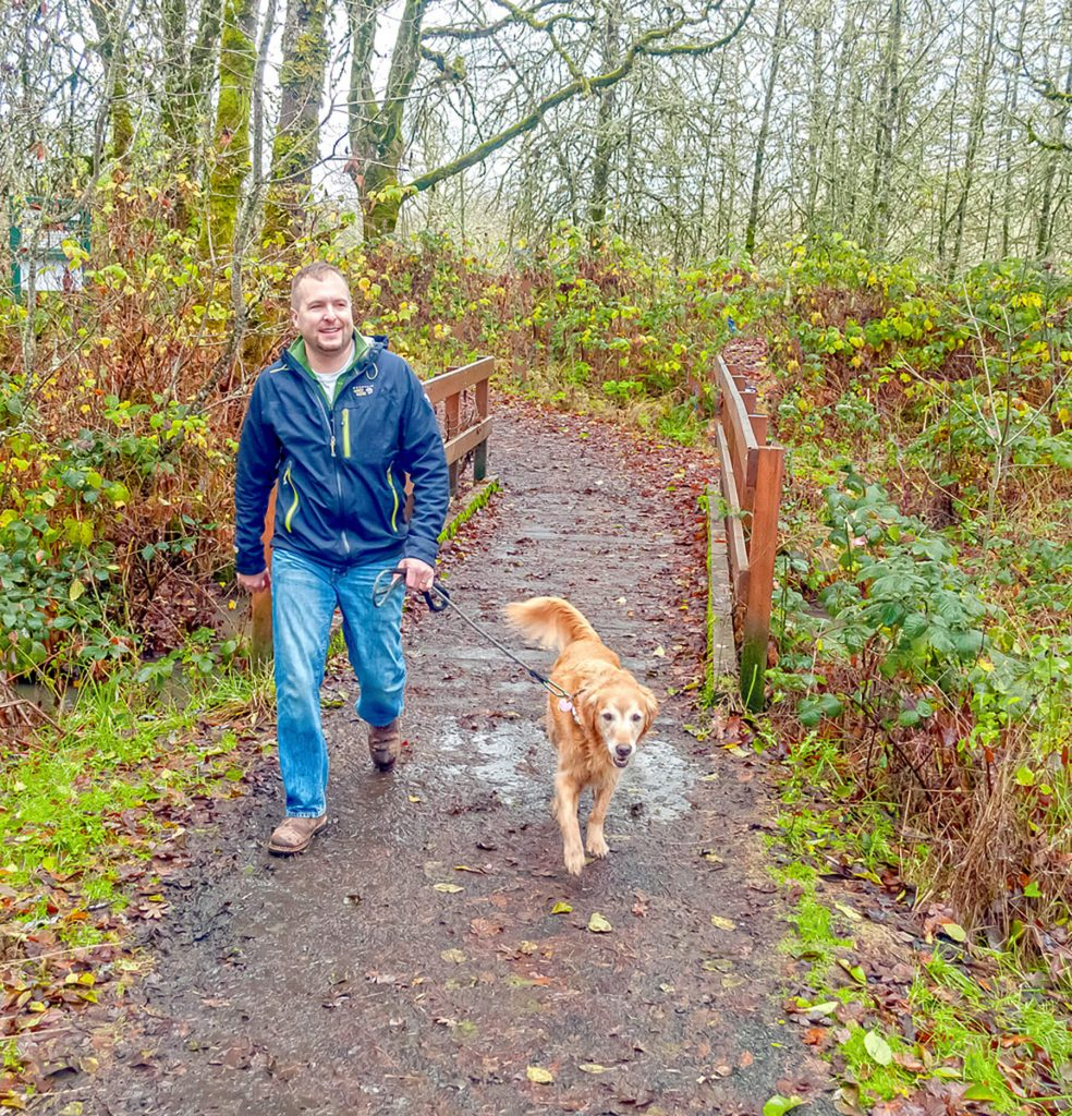 Greenbelt Land Trust. Dog Walker at Bald Hill Farm. Credit: Ricardo Small
