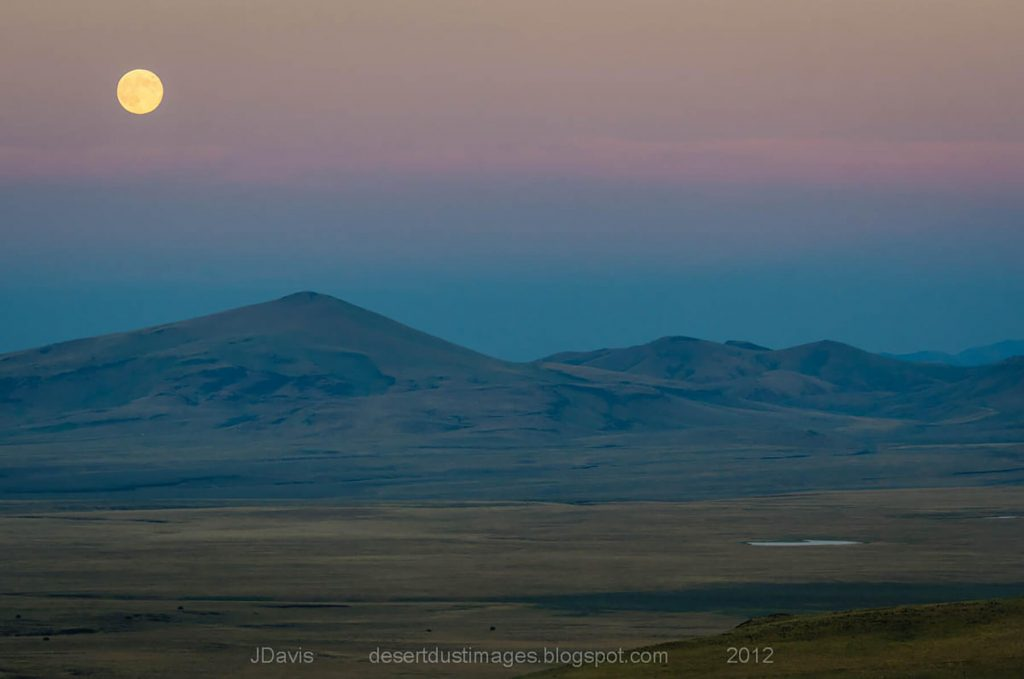 Oregon Desert Land Trust. Sunset falls over Beatys Butte - the Oregon Desert Land Trust contributed to preserving this important area for the benefit of wildlife and landscape connectivity by acquiring over 1,200 acres on and surrounding its summit. Photo: Jim Davis