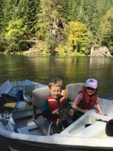 Kelley's kids in a boat this fall, searching for salmon